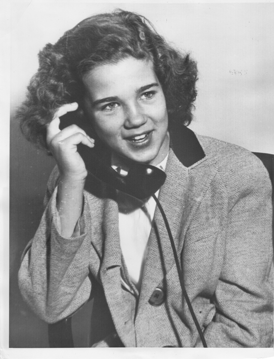 A likely staged photograph of Sally on the telephone after being rescued (courtesy of the author)