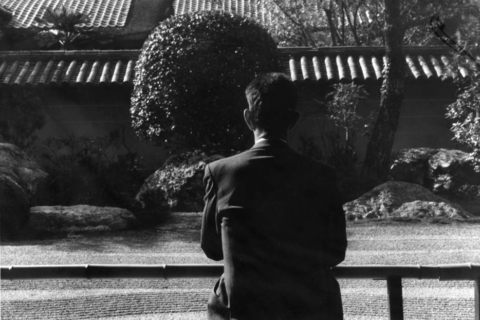 ||John Cage being studiously inactive at a Japanese rock garden.