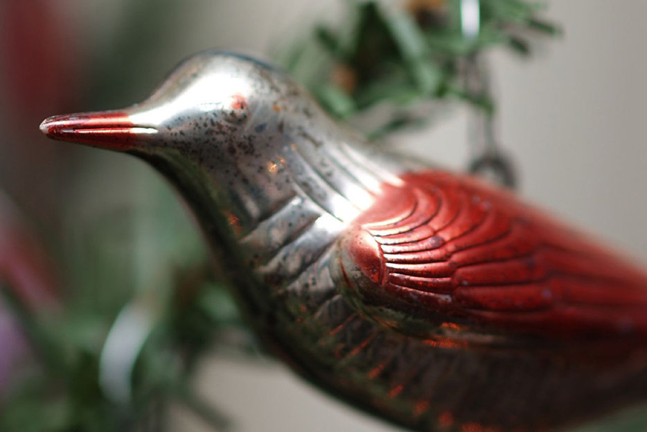|Christmas ornament of a bird in red and silver.|Photographed by Christina Rutz