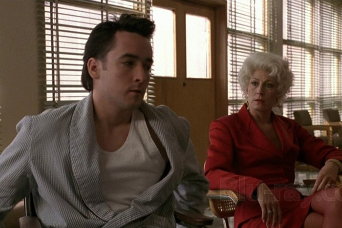 | John Cusack and Angelica Huston in Stephen Frears' The Grifters