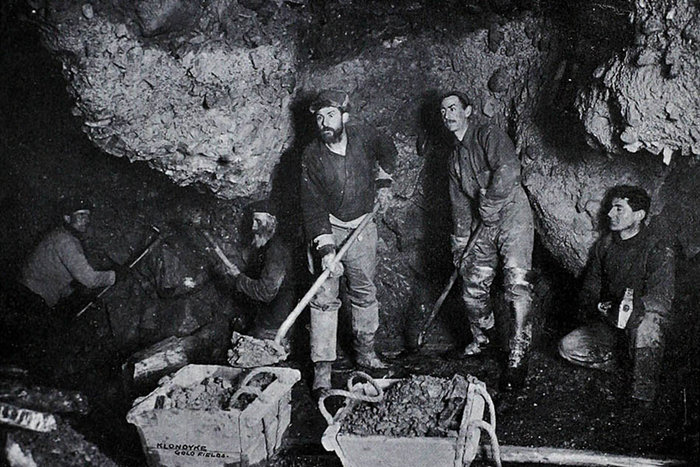 | Underground work, Bonanza Creek | From the Klondyke Souvenir published by H.J. Goetzman in 1901, via BC Bibliography Collection