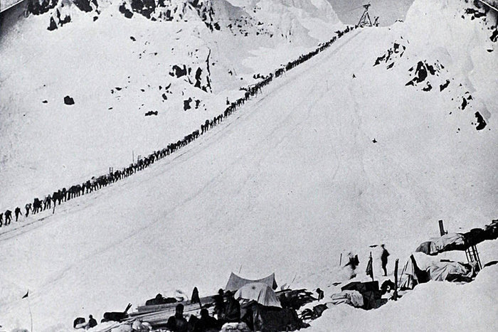 | Ascending Chilkoot Pass, 1989 | From the Klondyke Souvenir published by H.J. Goetzman in 1901, via BC Bibliography Collection